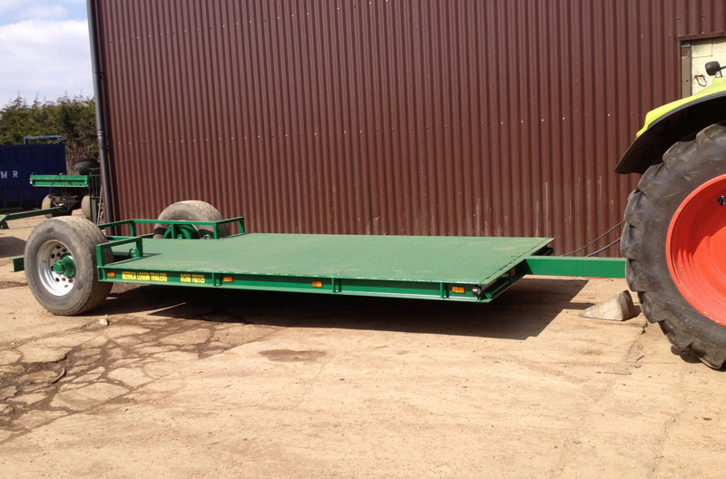 Green low loader trailer