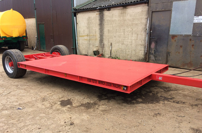 Red low loader trailer