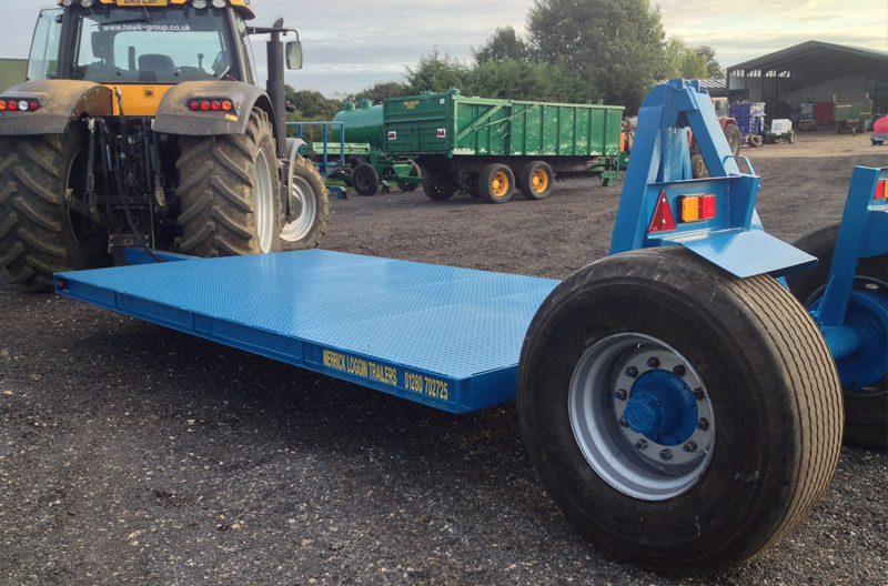 Blue low loader trailer